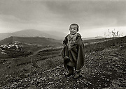 High Albania, the Accursed Mountains. Crying boy near the mountain village of Kalimash.
