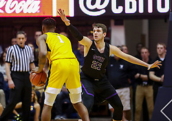 Mar 20, 2019; Morgantown, WV, USA; Grand Canyon Antelopes center Alessandro Lever (25) defends West Virginia Mountaineers forward Derek Culver (1) during the first half at WVU Coliseum. Mandatory Credit: Ben Queen