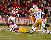 Nov 12, 2011; Fayetteville, AR, USA;  Arkansas Razorback running back Dennis Johnson (33) runs the ball for a touchdown asTennessee Volunteers defensive backs Byron Moore (3) looks on and Prentiss Waggner (23) make a block during the first half at Donald W. Reynolds Razorback Stadium. Arkansas defeated Tennessee 49-7. Mandatory Credit: Beth Hall-US PRESSWIRE