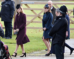 Princess Beatrice (left) and Princess Eugenie, leave after attending the morning church service at St Mary Magdalene Church in Sandringham, Norfolk.