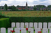 Ors Communal Cemetery,France..Site of the grave of W.E.S. Owen, ( back row 3rd from left ) the celebrated war poet who died on the 4th of November 1918, just 7 days before the Armistice. He died defending the Sambre Canal just behind the church spire in Ors to be seen in the background of this image..A cemetery from the final 100 days of the First World War. August to November 1918.
