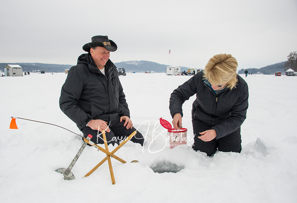 "Bill and Charlotte Born of Reading, MA set their ""lucky"" tip up on Meredith Bay Saturday morning during the Great Meredith Rotary Ice Fishing Derby.  (Karen Bobotas/for the Laconia Daily Sun)"