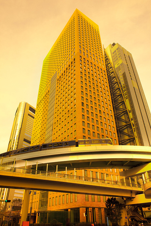 Skyline of skyscrapers at Shiodome Area in Shimbashi district with elevated train, Tokyo, Kanto Region, Honshu, Japan