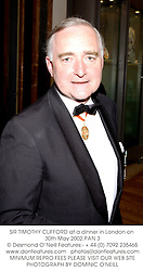 SIR TIMOTHY CLIFFORD at a dinner in London on 30th May 2002.PAN 3