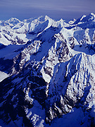 Aerial view south across peaks of the Fairweather Range in British Columbia toward 12,726 foot Mount Crillon in Glacier Bay National Park, Alaska.