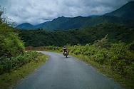 A man rides a motorbike on a side road, Muong La District, Son La Province, Vietnam, Southeast Asia