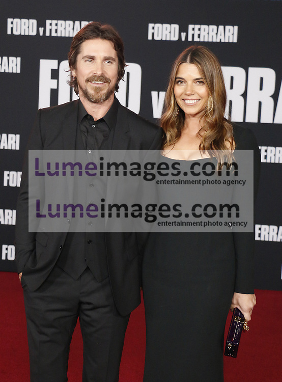 Christian Bale and Sibi Blažić at the Los Angeles premiere of 'Ford V Ferrari' held at the TCL Chinese Theatre in Hollywood, USA on November 4, 2019.