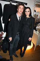 PEARL LOWE and musician DANNY GOFFEY at a party to launch Pearl Lowe's fashion held at The Cross. 141 Portland Road, Holland Park, W11 on 30th October 2006.<br />