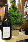 Cuvee Racine and a Christmas tree. Domaine Terres Georges. In Castelnau d'Aude. Minervois. Languedoc. Fibreglass vats. France. Europe. Bottle.