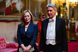 Chancellor of the Exchequer Philip Hammond arrives at the State Banquet at Buckingham Palace, London, on day one of US President Donald Trump's three day state visit to the UK.