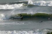 USA, Newport, RI - Surfers find waves at Ruggles Avenue point break.