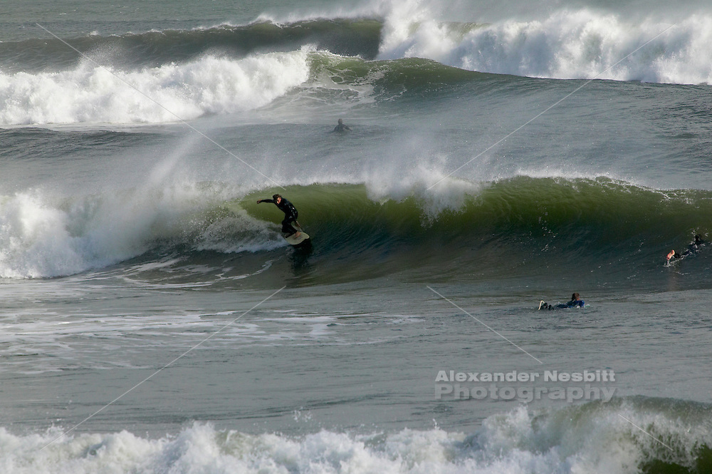 USA, Newport, RI - Surfers find waves at Ruggles Avenue point break.