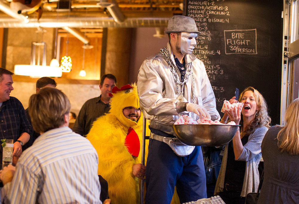 The Robot (played by chef Nelson Cabrera) and the Chicken (co-owner Mike Brown) go through their nightly popcorn-filled pantomime at Travail and the Rookery in Robbinsdale April 18, 2014.