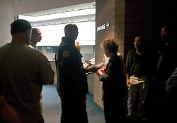 29 August, 2005. New Orleans, Louisiana.<br /> Hurricane Katrina hits New Orleans. As levees are breached and flooding begins to swamp the city, mayor Ray Nagin and his aides at the Hyatt Hotel appear helpless as they struggle to maintain communications, command and control in a city rapidly losing control.<br /> Photo; Charlie Varley.