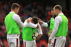 "Burnley's Ashley Westwood (centre) gets water in his eyes as he warms up with teammates at half time during the Premier League match at Anfield, Liverpool. PRESS ASSOCIATION Photo. Picture date: Saturday September 16, 2017. See PA story SOCCER Liverpool. Photo credit should read: Peter Byrne/PA Wire. RESTRICTIONS: EDITORIAL USE ONLY No use with unauthorised audio, video, data, fixture lists, club/league logos or ""live"" services. Online in-match use limited to 75 images, no video emulation. No use in betting, games or single club/league/player publications."