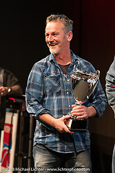 Don Cronin of Medazza Cycles in Cork, Ireland won 5th place in the big Freestyle Class for his Stechmucke 250cc MZ East German custom in the AMD World Championship of Custom Bike Building awards ceremony in the Intermot Customized hall during the Intermot International Motorcycle Fair. Cologne, Germany. Sunday October 7, 2018. Photography ©2018 Michael Lichter.