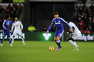 Cesc Fabregas of Chelsea breaks away from Bafetimbi Gomis of Swansea city. . Barclays Premier League match, Swansea city v Chelsea at the Liberty Stadium in Swansea, South Wales on Saturday 17th Jan 2015.<br /> pic by Andrew Orchard, Andrew Orchard sports photography.
