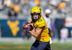 Oct 31, 2020; Morgantown, West Virginia, USA; West Virginia Mountaineers wide receiver Reese Smith (15) catches a pass during the second quarter against the Kansas State Wildcats at Mountaineer Field at Milan Puskar Stadium. Mandatory Credit: Ben Queen-USA TODAY Sports