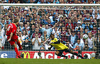 Photo: Chris Ratcliffe.<br />Liverpool v West Ham United. The FA Cup Final. 13/05/2006.<br />Steven Gerrard of Liverpool completes an excellent day with a penalty in the shoot out.