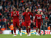 Football - 2018 / 2019 Premier League - Liverpool vs. Tottenham Hotspur<br /> Georginio Wijnaldum and Mohamed Salah of Liverpool celebrate in front of the Kop after Liverpool take the three points, at Anfield.<br /> <br /> COLORSPORT/ALAN MARTIN