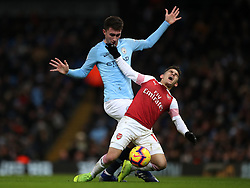 Manchester City's Aymeric Laporte (left) and Arsenal's Lucas Torreira during the Premier League match at the Etihad Stadium, Manchester.