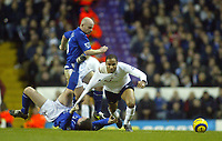 1/1/2005 - FA Barclays Premiership - Tottenham Hotspur v Everton - White Hart Lane<br />Tottenham Hotspur's Fredi Kanouté is tugged and kicked to the florr by Everton's David Weir (bottom) and Lee Carsley (behind)<br />Photo:Jed Leicester/Back Page Images