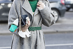 Details of a fashionista's outfit after the Lanvin Autumn / Winter 2017 Paris Men Fashion Week  show at Palais de Tokyo, Paris on Sunday January 22, 2017.