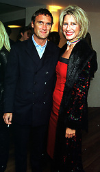 MR A A GILL and MISS NICOLA FORMBY  at a party in London on 2nd November 1999.MYL 38