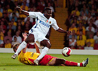 Photo: Ed Godden.<br /> Watford v Inter Milan. Pre Season Friendly. 08/08/2006.<br /> Watford's Jay DeMerit brings down Inter Milan's Obafemi Martins down in the area but no penalty is given.