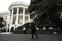 """ISP POOLWASHINGTON, DC - JULY 23: U.S. President Donald Trump walks back to the building during the 2018 Made in America Product Showcase July 23, 2018 at the White House in Washington, DC. The White House held the showcase to """"celebrates every state's effort and commitment to American-made products, and will allow these companies to speak with senior Administration officials, including the President, the Vice President, members of the Cabinet, and senior staff."""" (Photo by Alex Wong/Getty Images)"""