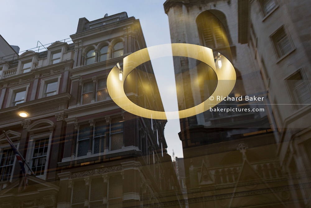 Circular lighting from the foyer of a City business and the other financial insitutions on Cornhill Street, in the City of London - the capital's fijnancial district, on 24th January 2019, in London, England.