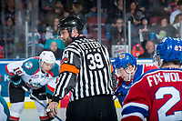 KELOWNA, CANADA - FEBRUARY 17: Referee Reagan Vetter stands at centre ice between the Kelowna Rockets and the Edmonton Oil Kings on February 17, 2018 at Prospera Place in Kelowna, British Columbia, Canada.  (Photo by Marissa Baecker/Shoot the Breeze)  *** Local Caption ***
