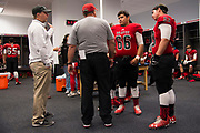 Iraan High School football head coach Mark Kirchhoff visits with Steven Garlock #66 before the state championship game at AT&T Stadium in Arlington, Texas on December 15, 2016. (Cooper Neill for The New York Times)