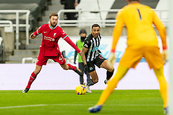 NEWCASTLE-UPON-TYNE, ENGLAND - Wednesday, December 30, 2020: Liverpool's Nathaniel Phillips (L) and Newcastle United's Callum Wilson during the FA Premier League match between Newcastle United FC and Liverpool FC at St. James' Park. The game ended in a goal-less draw. (Pic by David Rawcliffe/Propaganda)