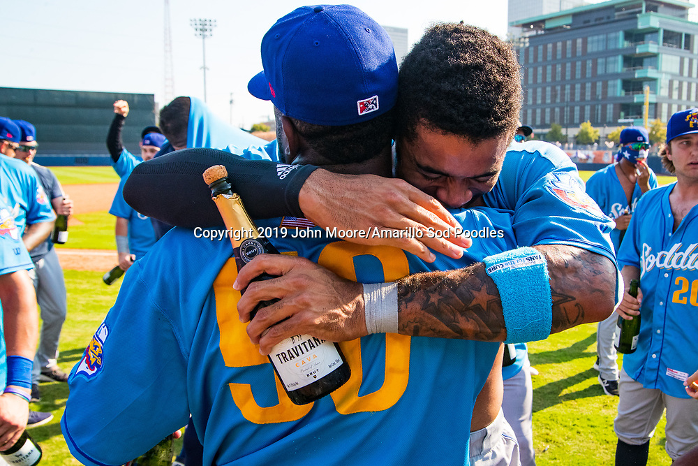 Amarillo Sod Poodles pitcher Carlos Belen (50) and Amarillo Sod Poodles outfielder Buddy Reed (12) celebrates after the Sod Poodles won against the Tulsa Drillers during the Texas League Championship on Sunday, Sept. 15, 2019, at OneOK Field in Tulsa, Oklahoma. [Photo by John Moore/Amarillo Sod Poodles]