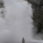 A young boy watches a spectacular geyser at Te Puia, Rotorua. Te Puia is the premier Maori cultural centre in New Zealand - a place of gushing waters, steaming vents, boiling mud pools and spectacular geysers. Te Puia also hosts National Carving and Weaving Schools and  daily maori culture performances including dancing and singing. Rotorua, 9th December 2010 New Zealand.  Photo Tim Clayton.