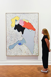 """© Licensed to London News Pictures. 04/09/2018. LONDON, UK. A staff member views """"Invasion of the innocent"""", 2018, at a preview of an exhibition called """"I Should Have Known Better"""" by German artist Daniel Richter at Galerie Thaddaeus Ropac in Mayfair.  The exhibition runs 5 to 28 September 2018.  Photo credit: Stephen Chung/LNP"""