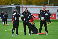 South Park coaches look relaxed during the Ryman League - Div One South match between Carshalton Athletic and South Park FC at War Memorial Sports Ground, Carshalton, United Kingdom on 19 November 2016. Photo by Jon Bromley.