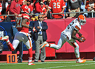 KANSAS CITY, MO - OCTOBER 27:  Wide receiver Josh Gordon #12 of the Cleveland Browns catches a 39-yard touchdown against defensive back Sean Smith #27 of the Kansas City Chiefs during the first half on October 27, 2013 at Arrowhead Stadium in Kansas City, Missouri.  (Photo by Peter Aiken/Getty Images) *** Local Caption *** Josh Gordon;Sean Smith
