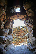 Picture and image of the prehistoric doorway with false triangular corbel of Nuraghe Losa, archaeological site, Bronze age (14 -9 th century BC), Abbasanta, Southern Sardinia..