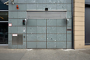 garage door which is the same looking as the wall