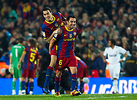 BARCELONA, SPAIN - NOVEMBER 29: Joy Xavi Hernandez of Barcelona celebrates his goal with Pedro during the La Liga match between Barcelona and Real Madrid at the Camp Nou Stadium on November 29, 2010 in Barcelona, Spain. (Photo by Manuel Queimadelos/DPPI)