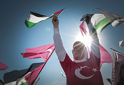 July 30, 2017 - Istanbul, Turkey - Protesters wave Turkish and Palestinian flags during a demonstration in Istanbul on July 30, 2017, to protest against measures taken by Israel in Jerusalem and to show solidarity with the Palestinians. Israel had angered Turkey by installing metal detectors and security cameras after a July 14 attack near the Haram al-Sharif holy site in Jerusalem, known to Jews as the Temple Mount, in which gunmen killed two policemen. The move sparked Muslim protests and deadly unrest, and the Israeli government removed the detectors on July 25 as well as  (Credit Image: © Belal Khaled/NurPhoto via ZUMA Press)