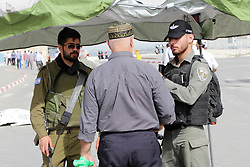 May 24, 2019, Qalandia, West Bank: Israeli border police stand guard as Palestinians make their way through Qalandia checkpoint to attend the second Friday prayer of the holy fasting month of Ramadan in Jerusalem's Al-Aqsa mosque, near Ramallah in the occupied West Bank. (Credit Image: © Ayat Arqawy/APA Images via ZUMA Wire)