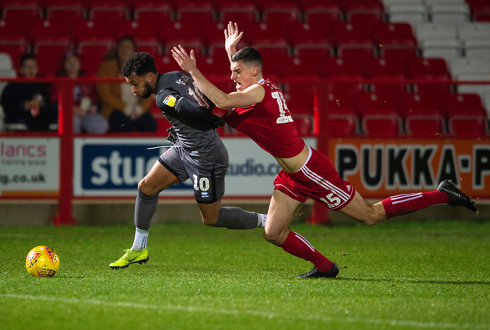 Lincoln City's Matt Green battles with Accrington Stanley's Matthew Platt<br /> <br /> Photographer Andrew Vaughan/CameraSport<br /> <br /> The EFL Checkatrade Trophy Second Round - Accrington Stanley v Lincoln City - Crown Ground - Accrington<br />  <br /> World Copyright © 2018 CameraSport. All rights reserved. 43 Linden Ave. Countesthorpe. Leicester. England. LE8 5PG - Tel: +44 (0) 116 277 4147 - admin@camerasport.com - www.camerasport.com