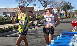 January 26, 2019 - Oceanside, California, United States - January 26, 2019, Santee, California_USA_2019 USATF 50km Race Walk Championships_| Nick Christie of El Cajon, at right, gets water. At left is Javier Mena Jara, of Ecuador. Nick led for much of the race but pulled out after getting sick. |_Photo Credit: Photo by Charlie Neuman (Credit Image: © Charlie Neuman/ZUMA Wire)