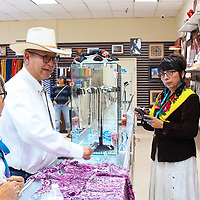 NACE Board of Directors Chairman Benjamin Bennett shopped for items inside the newly-opened Tuba City, Arizona, NACE store. He was joined by his wife, Emily. Window Rock, Arizona, store manager Amanda Tahe provided assistance.