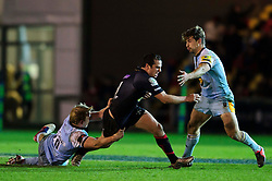 Dragons Fly-Half (#10) Dan Evans is tackled by Northampton replacement (#20) Ben Nutley during the second half of the match - Photo mandatory by-line: Rogan Thomson/JMP - Tel: Mobile: 07966 386802 18/11/2012 - SPORT - RUGBY - Rodney Parade - Newport. Newport Gwent Dragons v Northampton Saints - LV= Cup Round 2