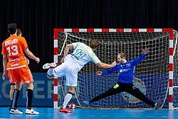 The Dutch handball player Bart Ravensbergen  in action against Jure Dolenec from Slovenia during the European Championship qualifying match on January 6, 2020 in Topsportcentrum Almere