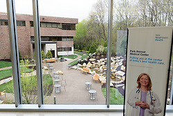Yale-New Haven Health Park Avenue Medical Center. Architect: Shepley Bulfinch. Contractor: Gilbane Building Company, Glastonbury, CT. James R Anderson Photography, New Haven CT photog.com. Date of Photograph 4 May 2016  Submission 25  © James R Anderson. Garden View with Signage, First Floor.